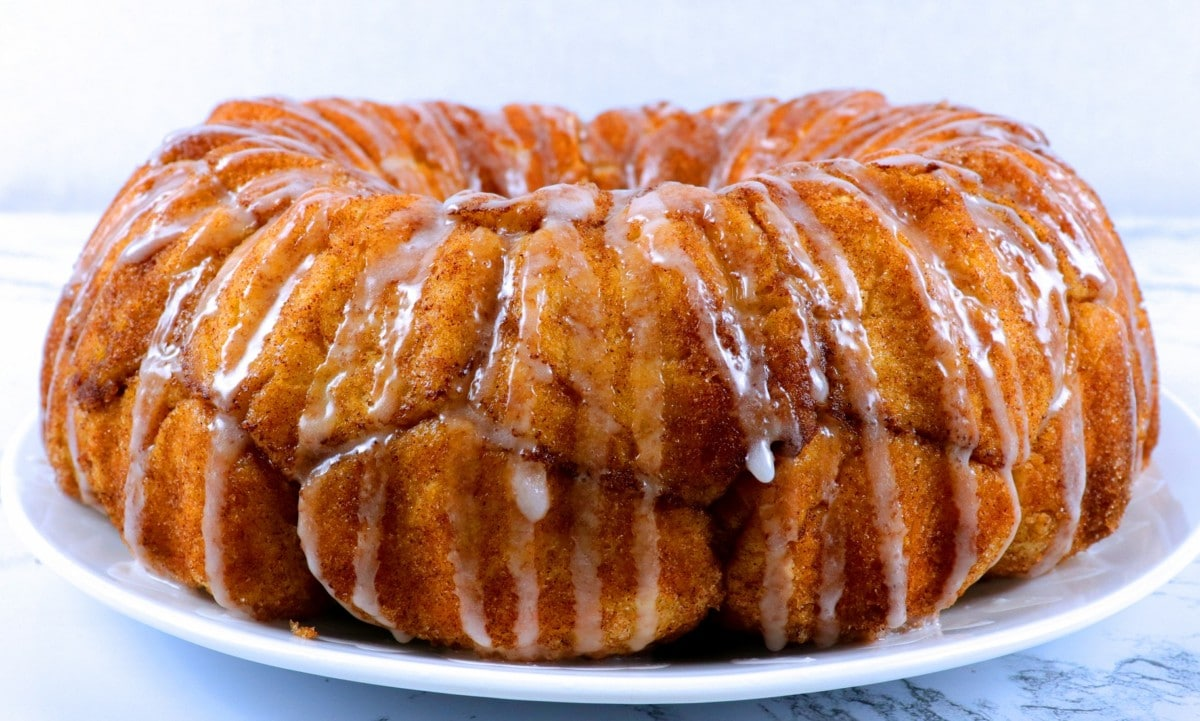 Homemade Monkey Bread on a plate with glaze