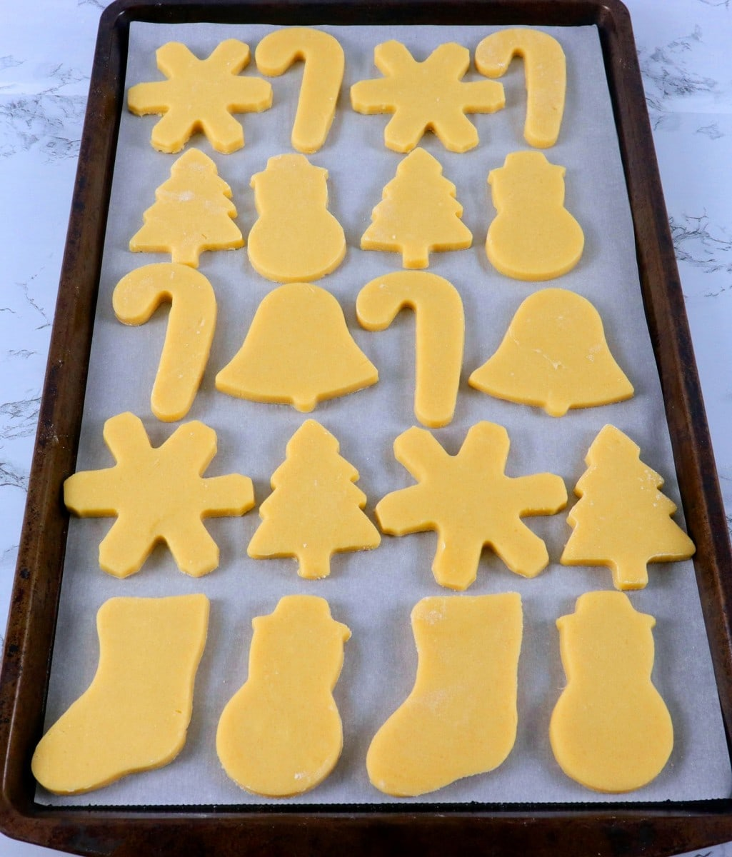 cookie dough shapes on baking pan