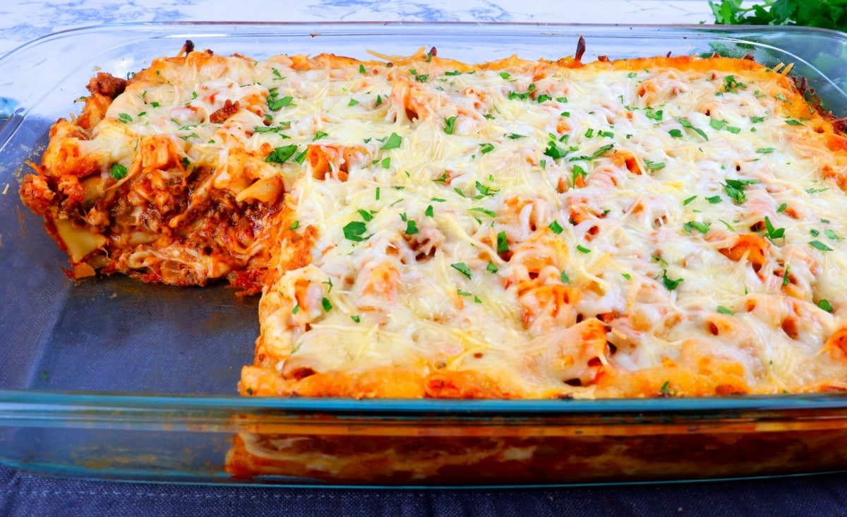 Pasta, cheese, and sauce in a casserole dish