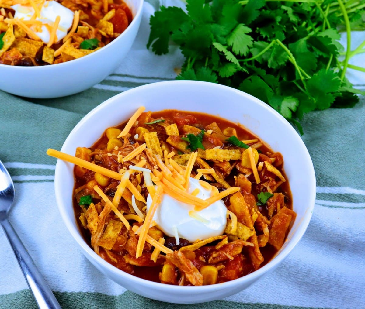 soup topped with sour cream and shredded cheese