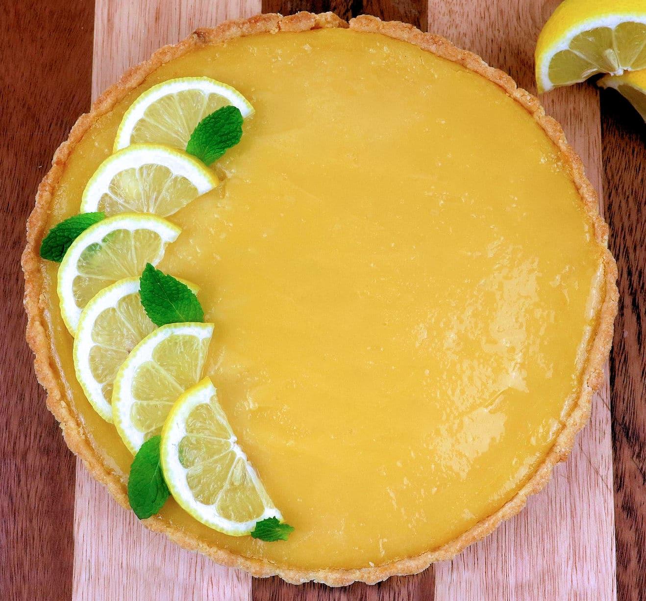 Lemon Tart with Lemon Slices and Mint Leaves